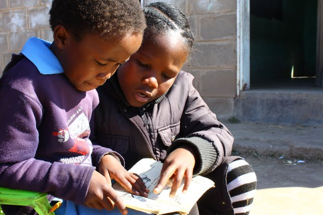 Girl's reading at the Discovery School
